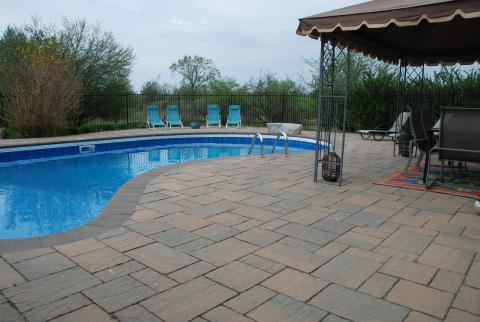 Poolside permeable pavement, in Halton Hills by Great Lakes Landscape
