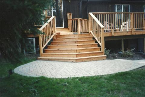 Sweeping wood steps to a wood deck.